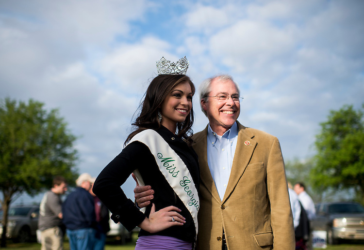 UNITED STATES - APRIL 17: Rep. John Barrow, D-Ga., poses for photos with 2014 Miss Georgia Sweet Onion Sarah DeLoach at the Law Enforcement Cookout at Wayne Dasher's pond house in Glennville, Ga., on Thursday, April 17, 2014. A crowd of over one thousand law enforcement, government officials and guests from across the state of Georgia gathered to enjoy BBQ and Brunswick stew at the annual event. (Photo By Bill Clark/CQ Roll Call)