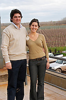 Ana Viola, director and daughter of Julio Viola the owner and her husband Pedro Soraire, manager Buenos Aires, vineyard in background Bodega Del Fin Del Mundo - The End of the World - Neuquen, Patagonia, Argentina, South America