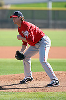 Andrew Taylor #31 of the Los Angeles Angels participates in pitchers fielding practice during spring training workouts at the Angels complex on February 16, 2011  in Tempe, Arizona. .Photo by:  Bill Mitchell/Four Seam Images.