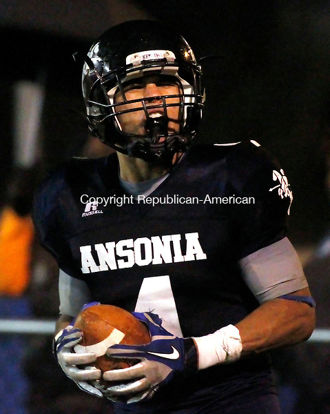 Ansonia, CT-02 November 2012-110212CM07-  Ansonia's Andrew Matos celebrates after scoring a touchdown in the 3rd quarter during their 41-12 win over Wolcott Friday night in Ansonia.  Christopher Massa Republican-American