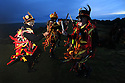 01/05/2012.  ..As May Day dawn breaks, The Powderkegs - Border Morris Dancers, brave gale force winds to dance on the top of Windgather Rocks, high up in The Peak District on the Derbyshire, Cheshire border near Buxton... Border Morris troupes 'black-up' and wear costumes that appear to be in tatters to help disguise their identities...The usual explanation for the black face is that it is for 'disguise', and that during the hard winters of the 17-18th Century out of work labourers and builders sought to anonymously supplement their income by a bit of dancing and begging. The use of the black face as a form of disguise is certainly well established in early 18th century England - so much so, that in 1723 it became a capital offence under the Waltham 'Black Act' to appear 'in disguise, either by mask or by blackened face'....All Rights Reserved - F Stop Press.  www.fstoppress.com. Tel: +44 (0)1335 300098.Copyrighted Image. Fees charged will reflect previously agreed terms or space rates for individual publications, states or country.