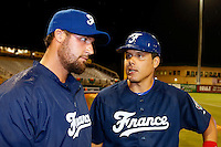 21 September 2012: Catcher Boris Marche talks to pitching coach Eric Gagne prior to France vs South Africa tie game 2-2, rain delayed at the end of the 9th inning at 1 AM, during the 2012 World Baseball Classic Qualifier round, in Jupiter, Florida, USA. Game to resume 22 September 2012 at noon.