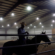 Cowboy Church. Texas, USA. 2007. A parishioner of the church on his horse in the Cowboy Church rodeo arena.