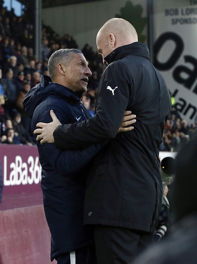 Burnley manager Sean Dyche (right) greets Brighton & Hove Albion manager Chris Hughton ahead of kick-off<br /> <br /> Photographer Rich Linley/CameraSport<br /> <br /> The Premier League - Burnley v Brighton and Hove Albion - Saturday 8th December 2018 - Turf Moor - Burnley<br /> <br /> World Copyright © 2018 CameraSport. All rights reserved. 43 Linden Ave. Countesthorpe. Leicester. England. LE8 5PG - Tel: +44 (0) 116 277 4147 - admin@camerasport.com - www.camerasport.com