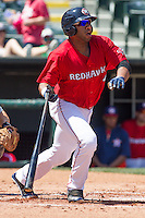 Oklahoma City RedHawks first baseman Jon Singleton (24) after hitting the ball during the Pacific League game at the Chickasaw Bricktown Ballpark against the New Orleans Zephyrs on April 13, 2014 in Oklahoma City, Oklahoma.  The RedHawks defeated the Zephyrs 4-3.  (William Purnell/Four Seam Images)