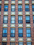 Windows of masonry high-rise building in the historic copper mining city of Butte, Montana