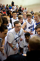 The Grandview High School unified basketball team listens to coach Cory Chandler (cq) during a time out in a game against Overland High School at Grandview High School in Aurora, Colorado, Wednesday, February 1, 2012. Unified sports teams, an outgrowth of the Special Olympics, are teams with both special needs and traditional high school students as players. The idea is that special needs kids shouldn't be separated and be allowed to participate in a competitive games as well at their schools...Photo by Matt Nager