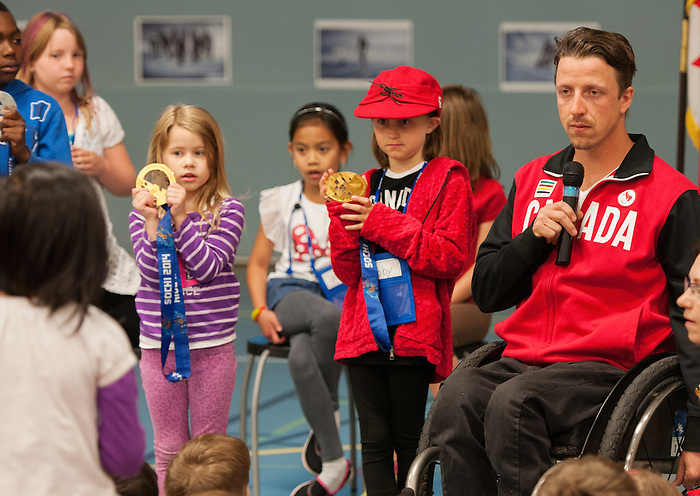 Calgary, AB - June 5 2014 - Josh Dueck speaks to the students of Douglasdale School during the Celebration of Excellence Heroes Tour in Calgary. (Photo: Matthew Murnaghan/Canadian Paralympic Committee)