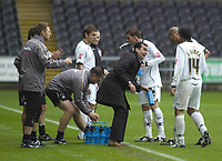 Pictured: Roberto Martínez Manager of Swansea City speaks to players during the match <br />