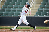 Michael Hickman (18) of the Kannapolis Intimidators follows through on his swing against the Lakewood BlueClaws at Kannapolis Intimidators Stadium on April 8, 2018 in Kannapolis, North Carolina.  The Intimidators defeated the BlueClaws 4-3 in game two of a double-header.  (Brian Westerholt/Four Seam Images)