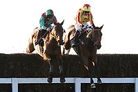 Miko De Beauchene ridden by R T Dunne (L) and Wide Receiver ridden by Felix De Giles in jumping action during the ladbrokes.com Kent National (Handicap Chase)