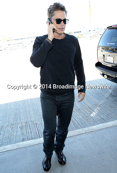 Pictured: Rob Lowe<br /> Mandatory Credit &copy; CALA/Broadimage<br /> Rob Lowe at the Los Angeles International Airport<br /> <br /> 4/7/14, Los Angeles, California, United States of America<br /> <br /> Broadimage Newswire<br /> Los Angeles 1+  (310) 301-1027<br /> New York      1+  (646) 827-9134<br /> sales@broadimage.com<br /> http://www.broadimage.com