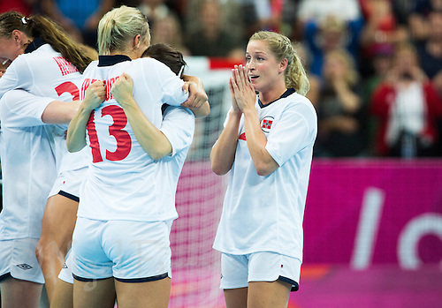 11 AUG 2012 - LONDON, GBR - Gøril Snorroeggen (NOR) (right) of Norway celebrates winning the women's London 2012 Olympic Games handball final against Montenegro at the Basketball Arena in the Olympic Park, in Stratford, London, Great Britain .(PHOTO (C) 2012 NIGEL FARROW)