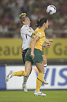 Australia defender (5) Cheryl Salisbury  heads the ball away from Norway forward (16) Ragnhild Gulbrandsen during their first round game at the 2007 FIFA Women's World Cup at Hangzhou Dragon Stadium in Hangzhou, China.  Norway tied Australia, 1-1.