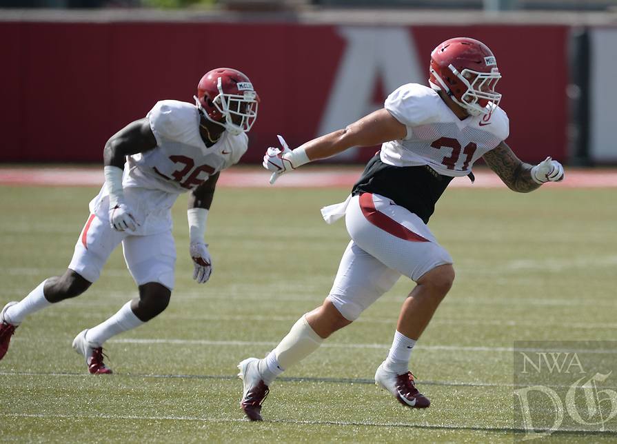 NWA Democrat-Gazette/ANDY SHUPE<br /> Arkansas linebackers Grant Morgan (31) and D'Vone McClure run through a drill Tuesday, Aug. 13, 2019, during practice at the university practice facility in Fayetteville. Visit nwadg.com/photos to see photographs from the practice.