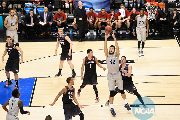 19 MAR 2015:  Bradley Hayes (42) of Georgetown University goes up for the pass against Felix Van Hofe (44) of Eastern Washington University during the 2015 NCAA Men's Basketball Tournament held at the Moda Center in Portland, OR.    Georgetown defeated Eastern Washington 84-74.  Jamie Schwaberow/NCAA Photos