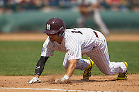 Mississippi State second baseman Brett Pirtle (13) dives back to first base during Game 11 of the 2013 Men's College World Series against the Oregon State Beavers on June 21, 2013 at TD Ameritrade Park in Omaha, Nebraska. The Bulldogs defeated the Beavers 4-1, to reach the CWS Final and eliminating Oregon State from the tournament. (Andrew Woolley/Four Seam Images)