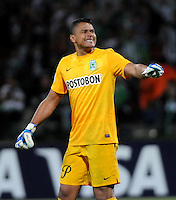 MEDELLIN- COLOMBIA - 13-02-2014: Luis Martinez jugador del Atletico Nacional de Colombia, celebra al final del partido entre Atletico Nacional y Newell´s Old Boys de la segunda fase, grupo 6, de la Copa Bridgestone Libertadores en el estadio Atanasio Girardot, de la ciudad de Medellin.   / Luis Martinez player of Atletico Nacional of Colombia, celebrates at the end of the match between Atletico Nacional and Newell´s Old Boys for the second phase, group 4, of the Copa Bridgestone Libertadores in the Atanasio Girardot stadium in Medellin city. Photo: VizzorImage / Luis Rios / Str.