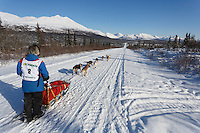 Marianna Mallory and team run down the trail on the Denali Highway with the Alaska Range in the background during the start day of the 2015 Junior Iditarod on Sunday March 1, 2015<br /> <br /> <br /> <br /> (C) Jeff Schultz/SchultzPhoto.com - ALL RIGHTS RESERVED<br />  DUPLICATION  PROHIBITED  WITHOUT  PERMISSION
