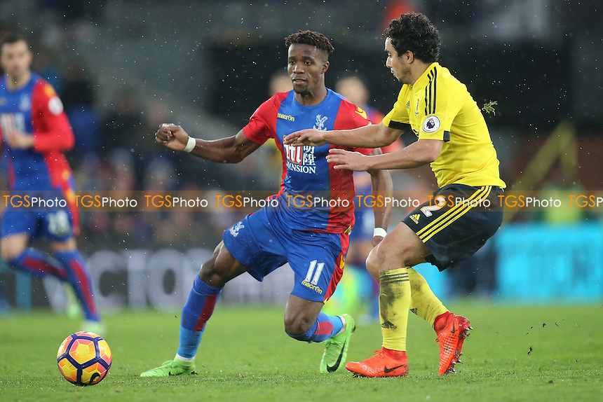 Wilfried Zaha of Crystal Palace and Fabio of Middlesbrough during Crystal Palace vs Middlesbrough, Premier League Football at Selhurst Park on 25th February 2017