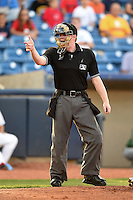 Umpire Josh Root makes a call during a game between the Fort Wayne TinCaps and Lake County Captains on August 21, 2014 at Classic Park in Eastlake, Ohio.  Lake County defeated Fort Wayne 7-8.  (Mike Janes/Four Seam Images)