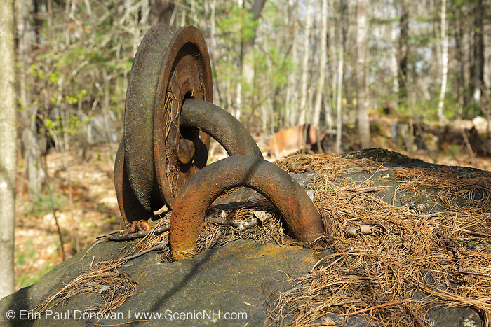 An old pulley in a boulder at the abandoned Redstone Granite quarry in Conway, New Hampshire.