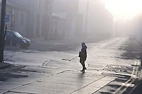 Second Bite Of Cherry!<br /> Drogheda, Fair Street, early morning Fog<br /> 7.00am The shape of person crossing from Scholes Lane to Bolton Street is silhouetted on the fog and street backlight. Cartier-Bresson's &quot;decisive moment&quot;? situation repeats itself enabling me to take the shot twice !