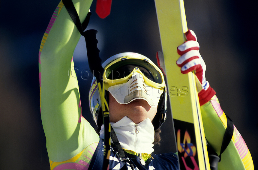 Skier holding his skis