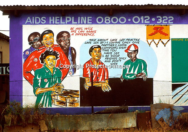 disiaids00256.  Social Issues, Aids: Aids education. A mural informing the public on the risks of HIV-Aids on June 16, 2000 in a residential area in Thokosa, a township outside Johannesburg, South Africa. About 4,5 million (About 10 percent of the population) South Africans are living with HIV-Aids..©Per-Anders Pettersson/ iAfrika Photos