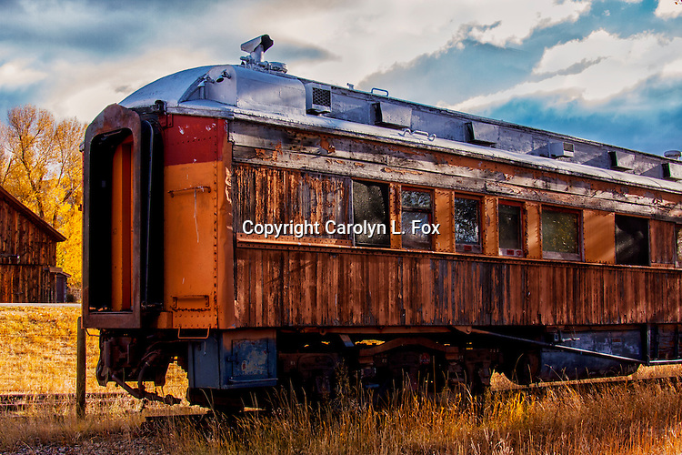 An old train car sits on a track in Montana.