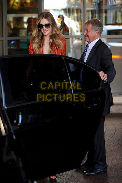 ROSIE HUNTINGTON-WHITELEY.Spotted in Central London, England..September 19th, 2011.**EXCLUSIVE ALL-ROUNDER**.full half length sunglasses shades orange leather jacket car driver.CAP/IA.©Ian Allis/Capital Pictures.