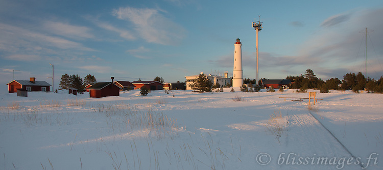 Marjaniemi Lighthouse on Hailuoto Island at sundown in early April   in the Gulf of Bothnia, Finland.