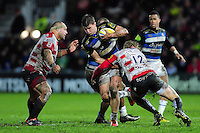 Ollie Devoto of Bath Rugby takes on the Gloucester defence. Aviva Premiership match, between Gloucester Rugby and Bath Rugby on March 26, 2016 at Kingsholm Stadium in Gloucester, England. Photo by: Patrick Khachfe / Onside Images