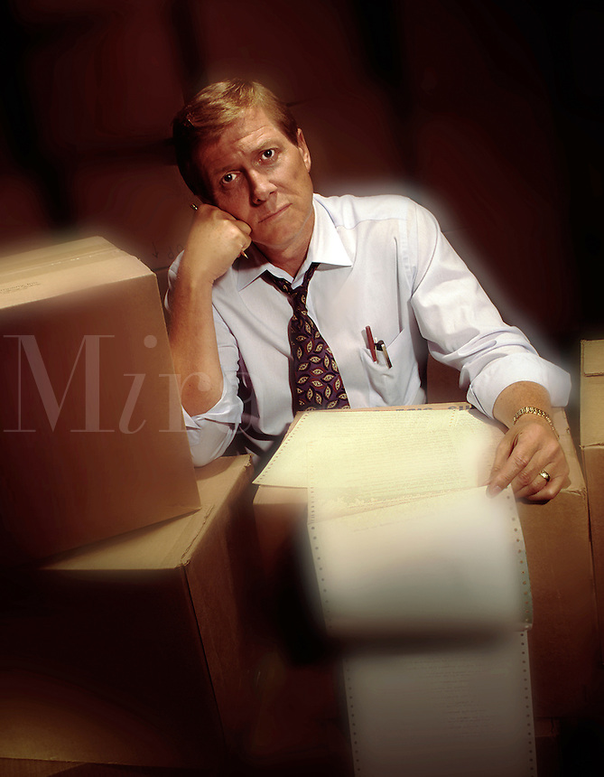 frustrated businessman in warehouse. delivery, shipping warehouse, business, man. men, male, expressions, emotions, frustrated, tired, overworked.