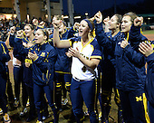 Michigan Wolverines Softball team members, including infielder Taylor Hasselbach (4), cheer before a game against the University of South Florida Bulls on February 8, 2014 at the USF Softball Stadium in Tampa, Florida.  Michigan defeated USF 3-2.  (Copyright Mike Janes Photography)