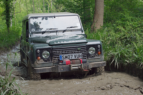 Land Rover Defender 90 TD4 competing at the ALRC National 2008 RTV Trial and  driving through flooded forest road after torrential rain. The Association of Land Rover Clubs (ALRC) National Rallye is the biggest annual motor sport oriented Land Rover event and was hosted 2008 by the Midland Rover Owners Club at Eastnor Castle in Herefordshire, UK, 22 - 27 May 2008. --- No releases available. Automotive trademarks are the property of the trademark holder, authorization may be needed for some uses.