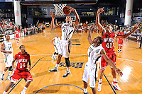 28 January 2012:  FIU guard-forward Dominique Ferguson (3) jumps to pull down a rebound before WKU guard-forward Vinny Zollo (41) and guard Jamal Crook (14) had a chance at the ball in the first half as the Western Kentucky University Hilltoppers defeated the FIU Golden Panthers, 61-51, at the U.S. Century Bank Arena in Miami, Florida.