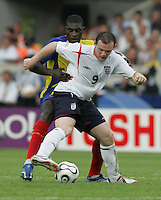 English forward (9) Wayne Rooney tries to get around Ecuadorian defender (17) Giovanny Espinoza.  England defeated Ecuador, 1-0, in their FIFA World Cup round of 16 match at Gottlieb-Daimler-Stadion in Stuttgart, Germany, June 25, 2006.