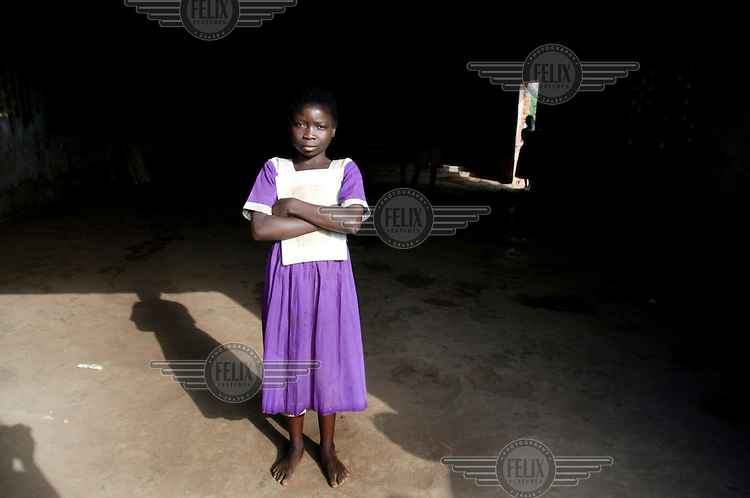 13 year old Loveness Banda stands in the Standard 1 classroom at Chikonje primary school.