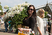 London, UK. 28 May 2016. On the last day of Chelsea Flower Show visitors take home plants and flowers they managed to purchase as the show closes.