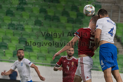 Adam Lang (L) of Hungary and Kostas Manolas (R) of Greece go for a header during the UEFA Nations' League qualifying match between Hungary and Greece at the Groupama Arena stadium in Budapest, Hungary on Sept. 11, 2018. ATTILA VOLGYI