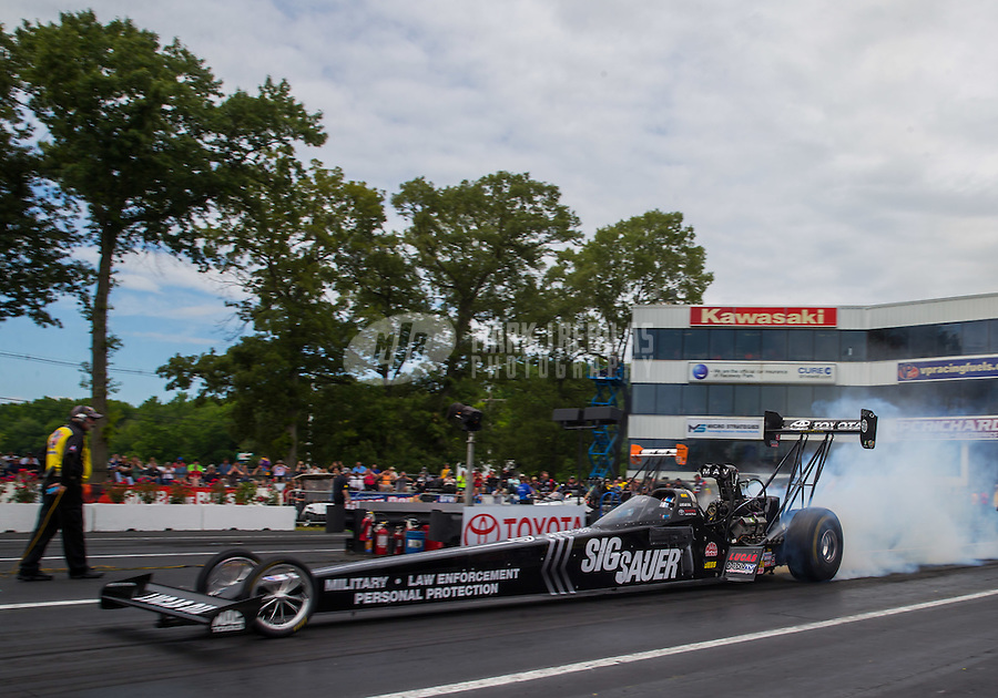 Jun 6, 2015; Englishtown, NJ, USA; NHRA top fuel driver Morgan Lucas during qualifying for the Summernationals at Old Bridge Township Raceway Park. Mandatory Credit: Mark J. Rebilas-