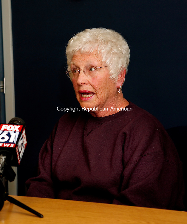 Waterbury, CT-30, December 2009-123009CM16 -- The barber shop on Hillside St., in Waterbury was the scene of a horrible event. The barber shop on Hillside St., in Waterbury was the scene of a horrible event.  Elaine Rosa, wife of John Rosa addresses press at Saint Mary's Hospital in Waterburty.  Christopher Massa Republican-American