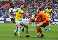 Bolton Wanderers' Clayton Donaldson putting pressure on Rotherham United's Clark Robertson and goalkeeper Marek Rodak<br /> <br /> Photographer Andrew Kearns/CameraSport<br /> <br /> The EFL Sky Bet Championship - Bolton Wanderers v Rotherham United - Wednesday 26th December 2018 - University of Bolton Stadium - Bolton<br /> <br /> World Copyright © 2018 CameraSport. All rights reserved. 43 Linden Ave. Countesthorpe. Leicester. England. LE8 5PG - Tel: +44 (0) 116 277 4147 - admin@camerasport.com - www.camerasport.com