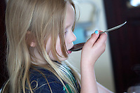 Polish girl age 6 tastes soup. Zawady Central Poland