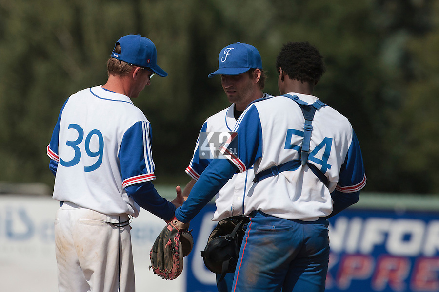 19 August 2010: Thomas Dourlens of Team France talks to Boris Rothermundt, next to Jean Antonio Samer, as he pitches against Slovakia during France 7-6 win over Slovakia, at the 2010 European Championship, under 21, in Brno, Czech Republic.