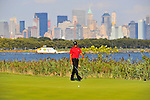 30 August 2009: Tiger Woods lines up his putt on the 14th green during the final round of The Barclays PGA Playoffs at Liberty National Golf Course in Jersey City, New Jersey.