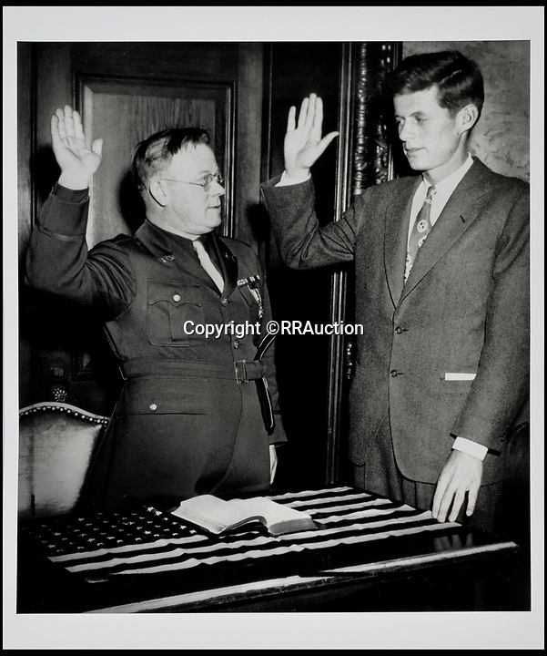 BNPS.co.uk (01202 558833)<br /> Pic: RRAuction/BNPS<br /> <br /> Kennedy in 1946 being sworn in as commander of VFW POST NO. 5880.<br /> <br /> Incredibly-rare photos highlighting the first foray into politics for John F. Kennedy that would eventually cost him his life have come to light.<br /> <br /> The 100 black and white snaps show a youthful-looking JFK from 1946, when he was campaigning to become a US congressman for the first time.<br /> <br /> The tragic future president is seen during an oration lesson where he was given help by an expert with public speaking and posture.<br /> <br /> The 29-year-old is also depicted mingling with the public at an annual parade and as well as celebrating his first political victory - a congressional primary vote - in June 1946.<br /> <br /> The images are being sold by US-based RR Auction.