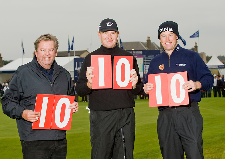 ALFRED DUNHILL LINKS CHAMPIONSHIP, ST.ANDREWS..CELEBRATING 10 YEARS OF THE CHAMPIONSHIP ON 10-10-10..CARNOUSTIE, 18TH GREEN..JOHANN RUPERT, CHAIRMAN OF THE CHAMPIONSHIP COMMITTEE, WITH ERNIE ELS AND LEE WESTWOOD..10-10-2010 PIC BY IAN MCILGORM