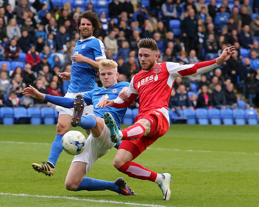 Fleetwood Town's Wes Burns battles with Peterborough United's Lewis Freestone<br /> <br /> Photographer David Shipman/CameraSport<br /> <br /> The EFL Sky Bet League One - Peterborough United v Fleetwood Town - Friday 14th April 2016 - ABAX Stadium  - Peterborough<br /> <br /> World Copyright &copy; 2017 CameraSport. All rights reserved. 43 Linden Ave. Countesthorpe. Leicester. England. LE8 5PG - Tel: +44 (0) 116 277 4147 - admin@camerasport.com - www.camerasport.com